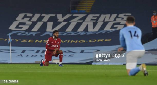 MANCHESTER ENGLAND NOVEMBER 08 Joe Gomez of Liverpool takes the knee in action the Premier League match between Manchester City and Liverpool at...