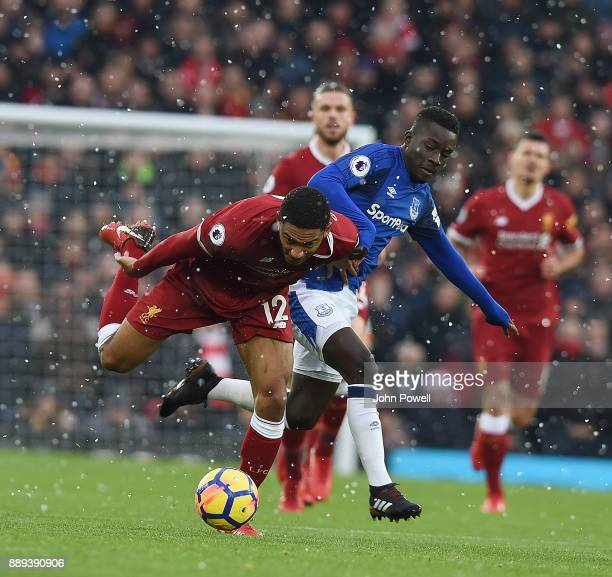 Joe Gomez of Liverpool with Idrissa Gana Gueye of Everton during the Premier League match between Liverpool and Everton at Anfield on December 10...