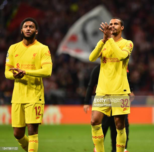 Joe Gomez of Liverpool with Joel Matip of Liverpool at the end of the UEFA Champions League group B match between Atletico Madrid and Liverpool FC at...