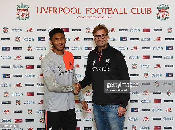 Joe Gomez of Liverpool with Jurgen Klopp manager of Liverpool after signing a new contract at Melwood Training Ground on January 27, 2017 in...