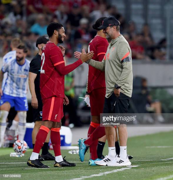 Joe Gomez of Liverpool with Jurgen Klopp manager of Liverpool as he comes onto the pitch for the first time after his injury during the Pre Season...