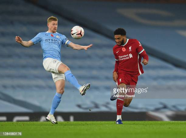 Joe Gomez of Liverpool with Kevin De Bruyne of Manchester City during the Premier League match between Manchester City and Liverpool at Etihad...
