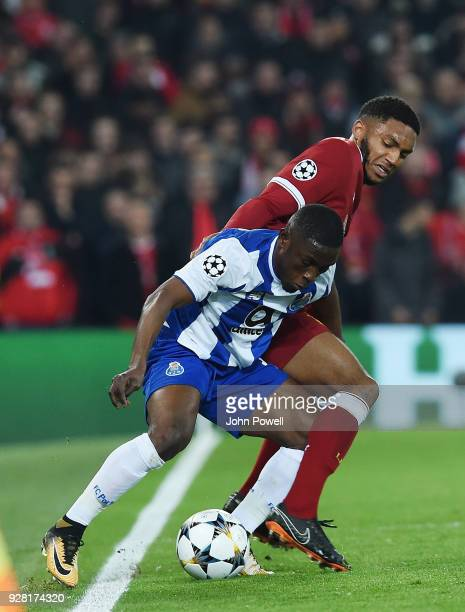 Joe Gomez of Liverpool with Majeed Waris of Fc Porto during the UEFA Champions League Round of 16 Second Leg match between Liverpool and FC Porto at...