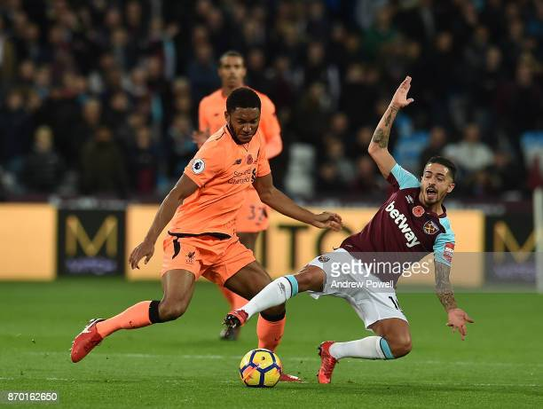 Joe Gomez of Liverpool with Manuel Lanzini of West Hamduring the Premier League match between West Ham United and Liverpool at London Stadium on...