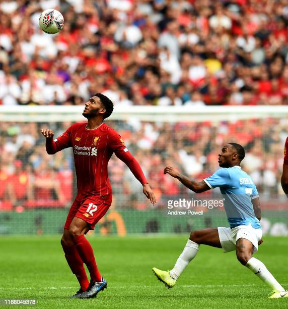 Joe Gomez of Liverpool with Raheem Sterling of Man City during the FA Community Shield match between Liverpool and Manchester City at Wembley Stadium...