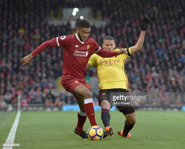 Joe Gomez of Liverpool with Richarlison of Watford during the Premier League match between Liverpool and Watford at Anfield on March 17 2018 in...