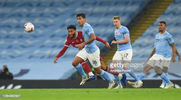 Joe Gomez of Liverpool with Rodri of Manchester City during the Premier League match between Manchester City and Liverpool at Etihad Stadium on...