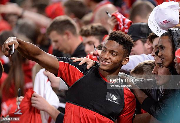 Joe Gomez takes a selfie with fans during a Liverpool FC training session at Suncorp Stadium on July 16 2015 in Brisbane Australia