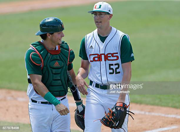 Joe Gomez talks to Frankie Bartow of the Miami Hurricanes after the final out of the fifth inning against the Florida AM Rattlers on May 1 2016 at...