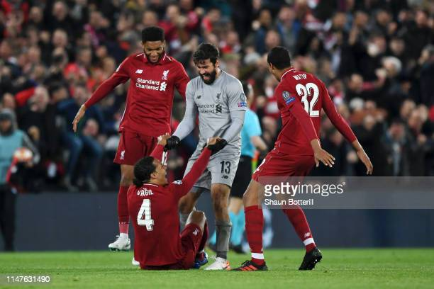 Joe Gomez Virgil van Dijk Alisson and Joel Matip of Liverpool celebrate victory after the UEFA Champions League Semi Final second leg match between...