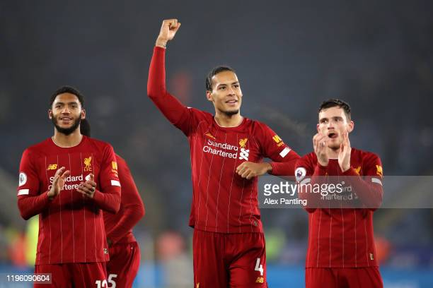 Joe Gomez Virgil van Dijk and Andy Robertson of Liverpool celebrate to their fans after the Premier League match between Leicester City and Liverpool...