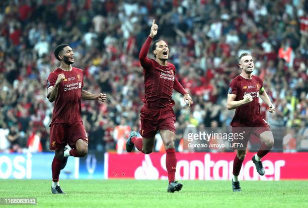 Joe Gomez Virgil van Dijk and Jordan Henderson of Liverpool celebrate victory after the penalty shoot out following the UEFA Super Cup match between...
