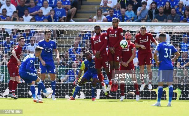 Joe Gomez Virigl van Dijk Jordan Henderson and James Milner of Liverpool in a wall during the Premier League match between Leicester City and...