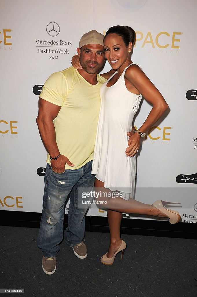 Joe Gorga and Melisssa Gorga pose backstage at the L*Space By Monica Wise show during Mercedes-Benz Fashion Week Swim 2014 at Cabana Grande at the Raleigh on July 21, 2013 in Miami, Florida.
