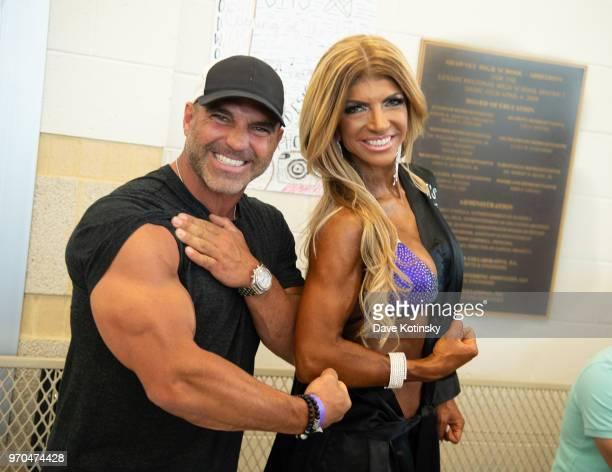 Joe Gorga and Teresa Giudice pose at the NPC South Jersey Bodybuilding Championships on June 9 2018 in Medford New Jersey