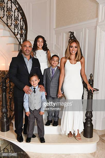 Joe Gorga Joey Gorga Jr Antonia Gorga Gino Gorga and Melissa Gorga pose at home before their son's Gino Gorga's First Communion on May 21 2016 in...