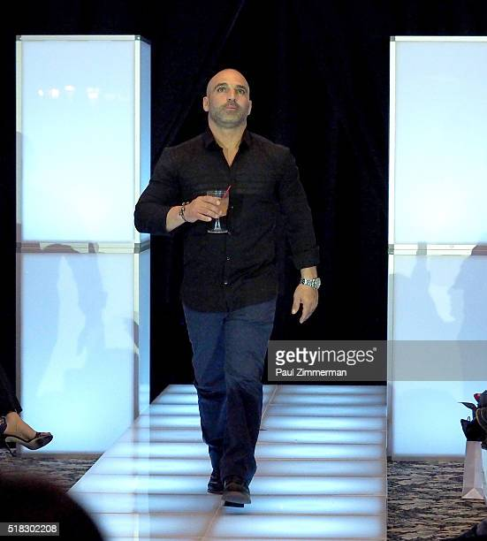Joe Gorga walks the runway at the envy By Melissa Gorga Fashion Show at Macaluso's on March 30 2016 in Hawthorne New Jersey