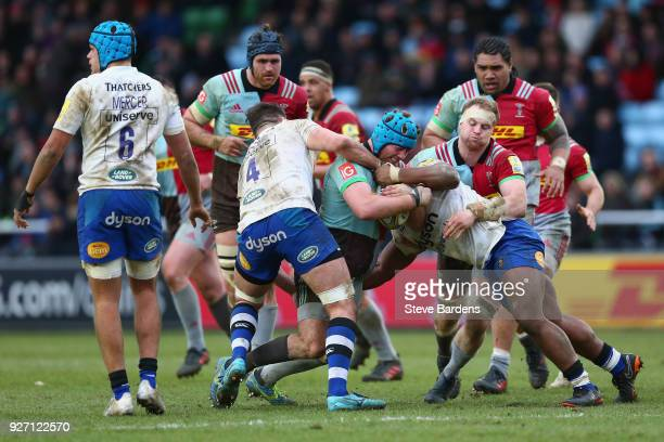 Joe Gray of Harlequins is tackled by Elliott Stooke of Bath Rugby during the Aviva Premiership match between Harlequins and Bath Rugby at Twickenham...