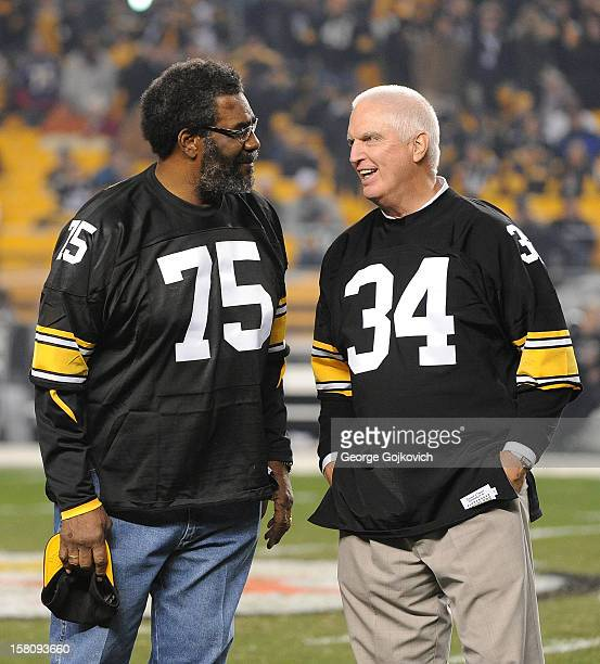 Joe Greene and Andy Russell former players for the Pittsburgh Steelers talk while on the field during halftime of a game between the Baltimore Ravens...