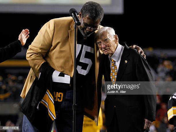 Joe Greene hugs Dan Rooney after having his retired from the Pittsburgh Steelers organization on November 2 2014 against the Baltimore Ravens at...