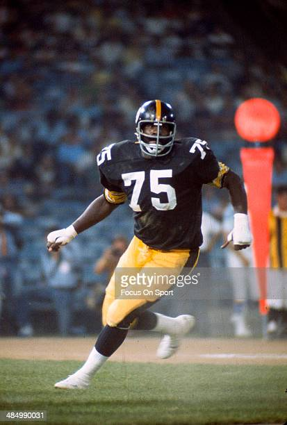 Joe Greene of the Pittsburgh Steelers pursues the play against the Baltimore Colts during an NFL football game October 30 1977 at Memorial Stadium in...