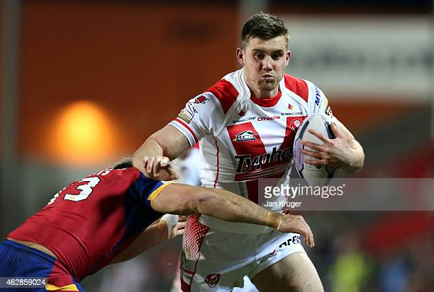 Joe Greenwood of St Helens holds off Gregory Mounis of Catalans Dragons during the First Utility Super League match between St Helens and Catalans...