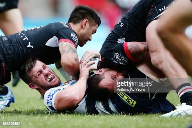 Joe Greenwood of the Titans is tackled by Bodene Thompson of the Warriors during the round five NRL match between the New Zealand Warriors and the...