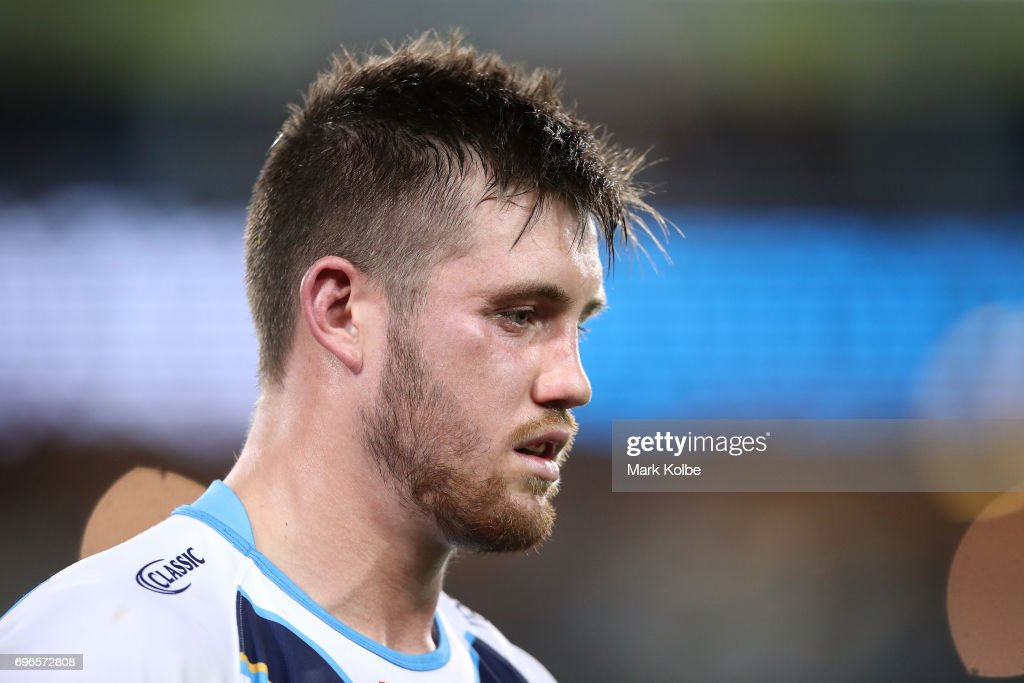Joe Greenwood of the Titans leaves the field after receiving a head knock during the round 15 NRL match between the South Sydney Rabbitohs and the Gold Coast Titans at ANZ Stadium on June 16, 2017 in Sydney, Australia.