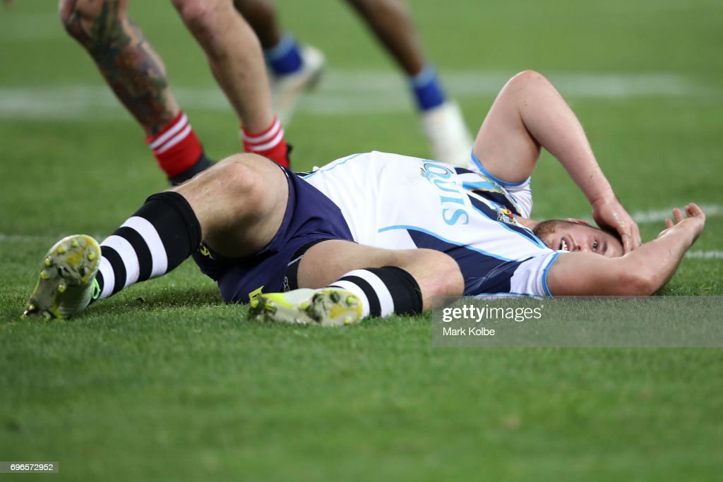 Joe Greenwood of the Titans lies injured on the ground after receiving a head knock during the round 15 NRL match between the South Sydney Rabbitohs and the Gold Coast Titans at ANZ Stadium on June 16, 2017 in Sydney, Australia.