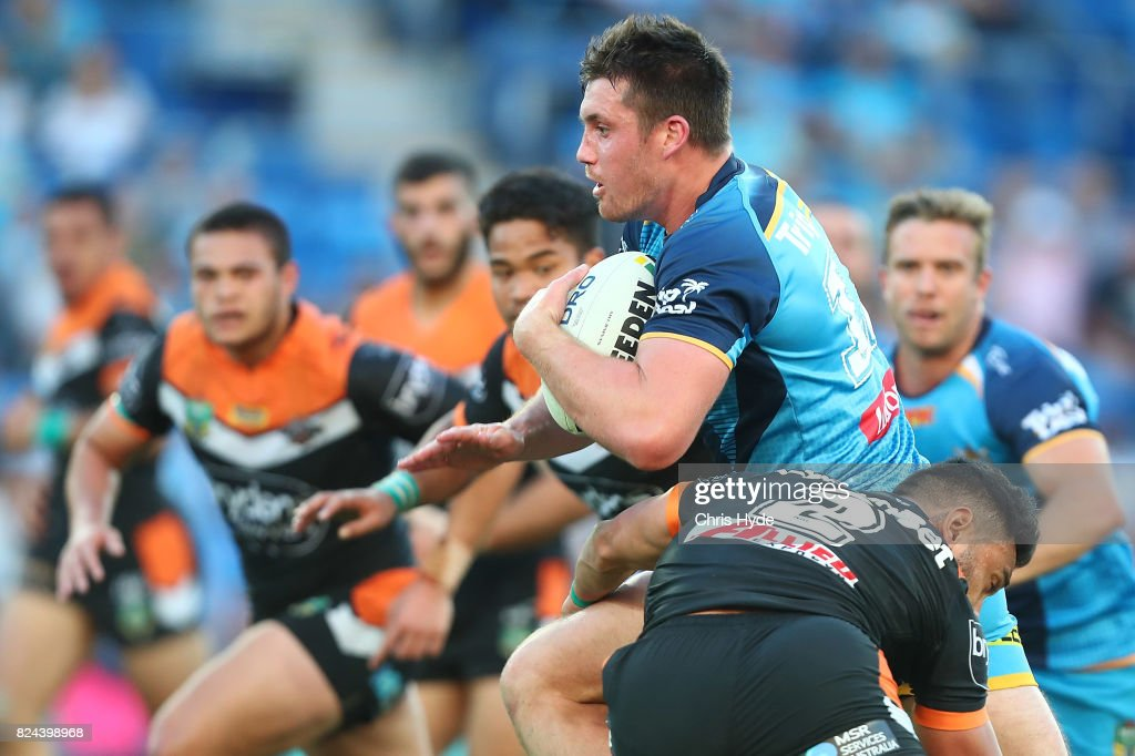 Joe Greenwood of the Titans runs the ball during the round 21 NRL match between the Gold Coast Titans and the Wests Tigers at Cbus Super Stadium on July 30, 2017 in Gold Coast, Australia.