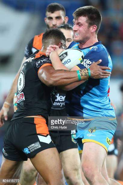 Joe Greenwood of the Titans runs the ball during the round 21 NRL match between the Gold Coast Titans and the Wests Tigers at Cbus Super Stadium on...