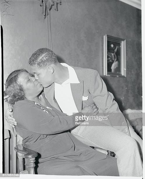 Joe Greets His Ma in Approved Fashion Pompton Lakes NJ Joe Louis the 'Brown Bomber' from Detroit who will attempt to blast Primo Carnera out of the...