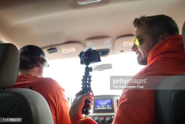 Joe Guerrero, right, interviews Shannon Wirth from the front seat as he and his team drive to Home Depot on Tuesday, May 14 in Chesapeake, VA....