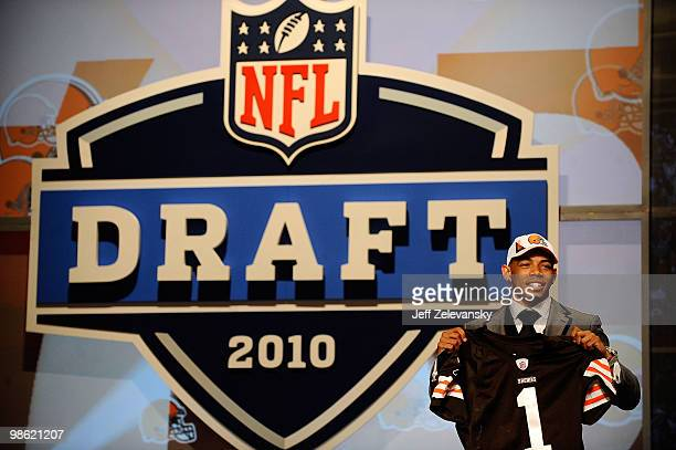 Joe Haden from the Florida Gators holds up a Cleveland Browns jersey after he was selected overall by the Browns during the first round of the 2010...