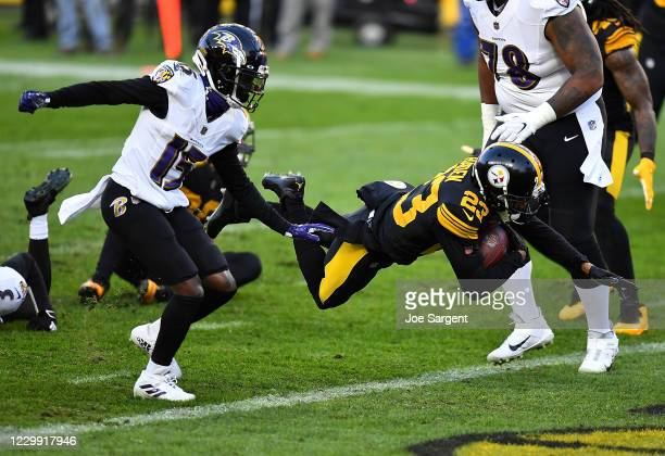 Joe Haden of the Pittsburgh Steelers carries the ball for a touchdown after intercepting a pass during the first quarter against the Baltimore Ravens...