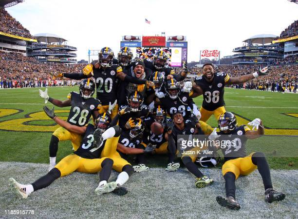 Joe Haden of the Pittsburgh Steelers celebrates with teammates after an interception in the fourth quarter against the Cleveland Browns on December...