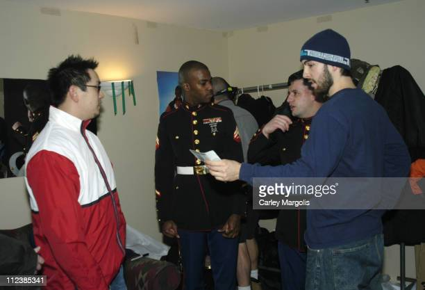 Joe Hahn and Rob Bourdon of Linkin Park listen to CPL Casey Reefer and CPL Oscar Castaneda of the US Marine Corps tell of their experiences in Iraq...