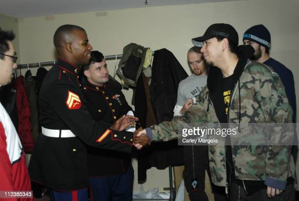 Joe Hahn Phoenix Mike Shinoda and Rob Bourdon of Linkin Park listen to CPL Casey Reefer and CPL Oscar Castaneda of the US Marine Corps tell of their...