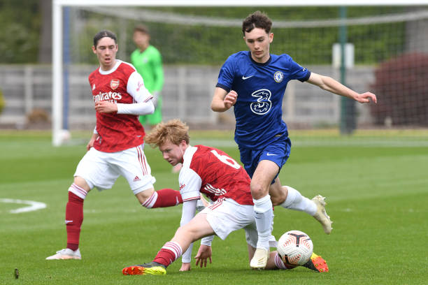 Joe Haigh of Chelsea rides a challenge during the U18 Premier League match between Chelsea and Arsenal at Chelsea Training Ground on May 12, 2021 in...