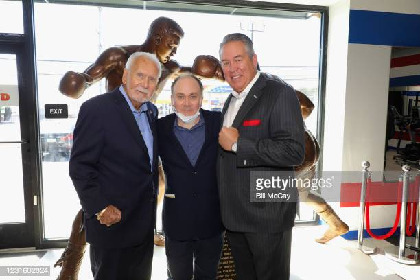 """Joe Hand Sr, Chris Collins and Joe Hand Jr attend the 50th Anniversary Ali-Frazier """"Fight of the Century"""" Statue Dedication on March 8, 2021 at Joe..."""