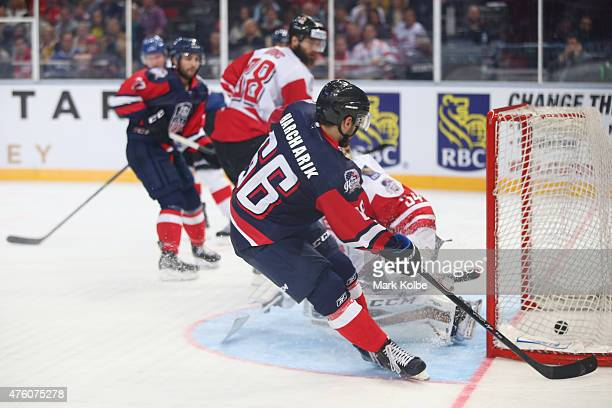 Joe Harcharik of the United States of America scores a goal during the 2015 Ice Hockey Classic match between the Unites States and Canada at...