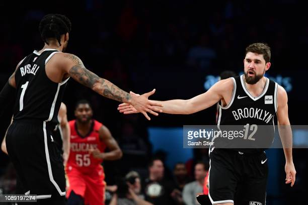 Joe Harris highfives D'Angelo Russell of the Brooklyn Nets after scoring during the third quarter of the game against the Brooklyn Nets at Barclays...