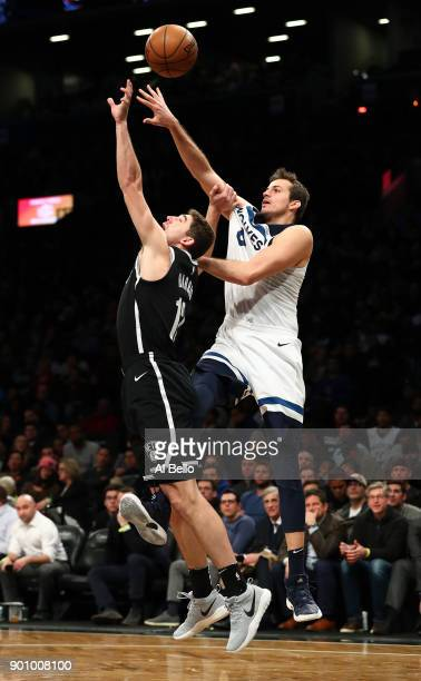 Joe Harris of the Brooklyn Nets and Nemanja Bjelica of the Minnesota Timberwolves battle for the ball during their game at Barclays Center on January...