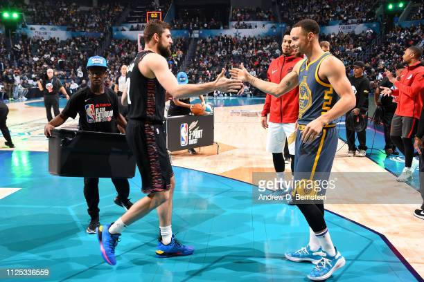 Joe Harris of the Brooklyn Nets and Stephen Curry of the Golden State Warriors high five during the 2019 Mtn Dew 3Point Contest as part of the State...