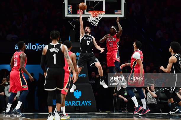 Joe Harris of the Brooklyn Nets attempts a layup against Jrue Holiday of the New Orleans Pelicans during the fourth quarter of the game at Barclays...