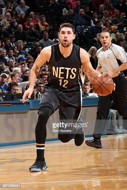 Joe Harris of the Brooklyn Nets brings the ball up court during the game against the Indiana Pacers on January 5 2017 at Bankers Life Fieldhouse in...