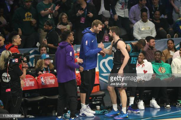 Joe Harris of the Brooklyn Nets celebrates with Dirk Nowitzki of the Dallas Mavericks during in the 2019 Mtn Dew 3Point Contest as part of State Farm...
