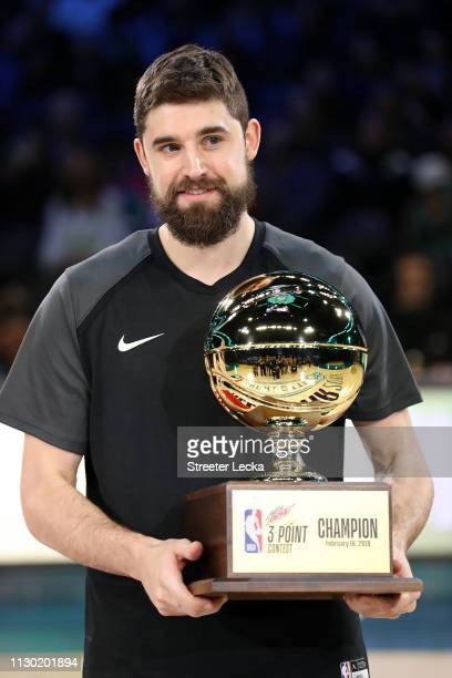 Joe Harris of the Brooklyn Nets celebrates with the trophy after winning the MTN DEW 3Point Contest as part of the 2019 NBA AllStar Weekend at...