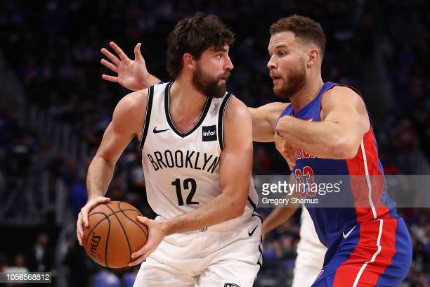 Joe Harris of the Brooklyn Nets defended by Blake Griffin of the Detroit Pistons during the home opener at Little Caesars Arena on October 17 2018 in...
