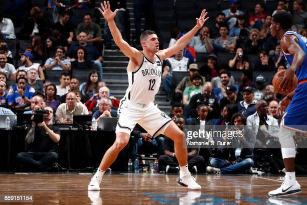 Joe Harris of the Brooklyn Nets defends against the New York Knicks during a preseason game on October 8 2017 at Barclays Center in Brooklyn New York...